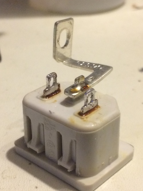 The power plug, cleaned of solder and chunks of wire
