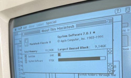 An extreme close-up on the About This Macintosh window, showing the computer has 10MB of RAM and is running System 7.0.1