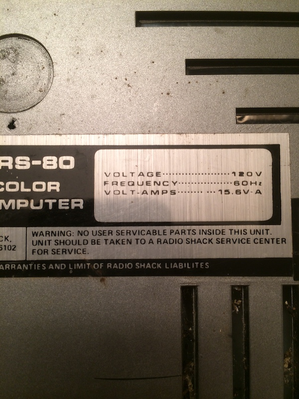 CoCo warning sticker - No user servicable parts inside this unit. Unit should be taken to a Radio Shack Service Center for service. Voltage 120V, Frequency 60Hz, Volt-Amps 15.6V - A