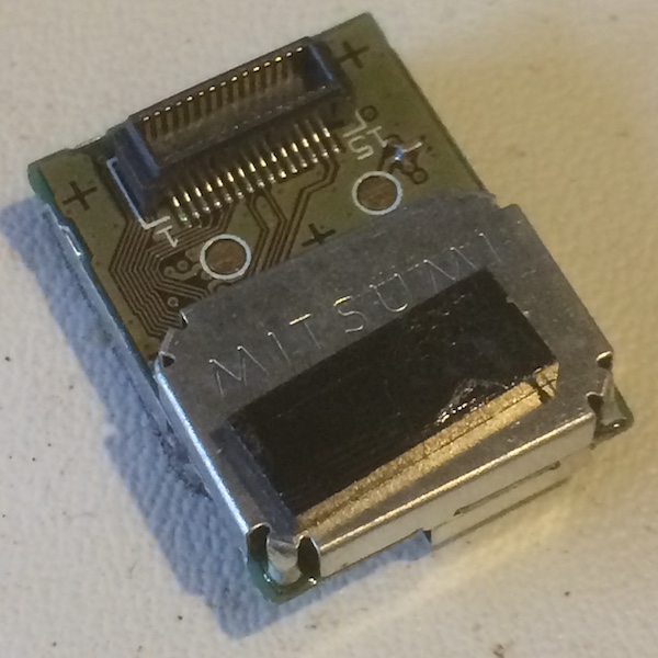 This wifi module reads 'MITSUMI' on it and has a similar connector to other Mitsumi interconnect boards we've seen on the Super Famicom and Sharp X68000