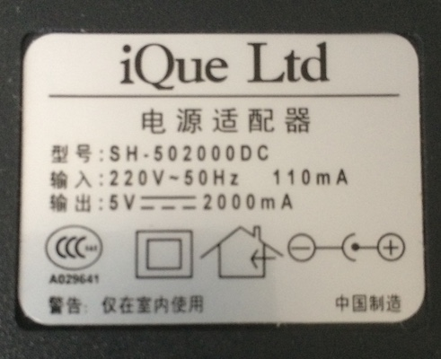 The label from the original Chinese power supply. It says 220V input, 5V 2000mA output. Centre positive.