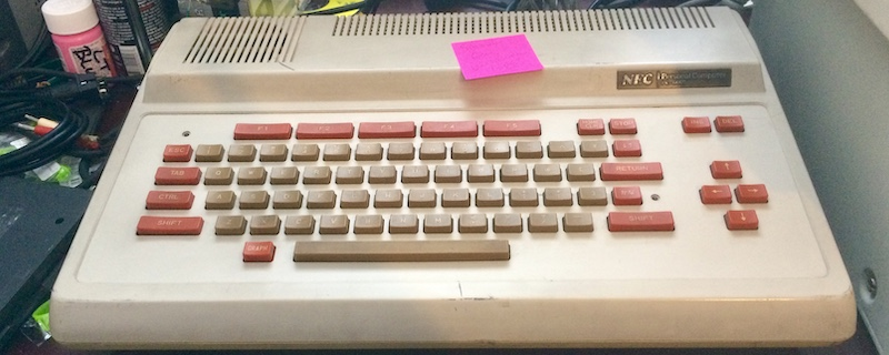 The PC-6001 sitting on my desk, ready for more adventure. The sticky note says 'sound gone - maybe electrolytic caps?'