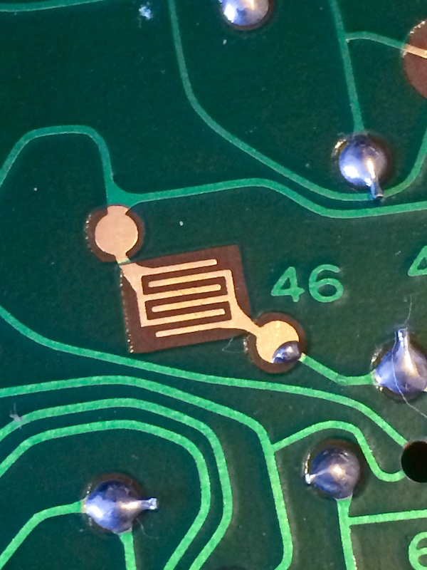 The test pad for #46 has a little solder glob on it.