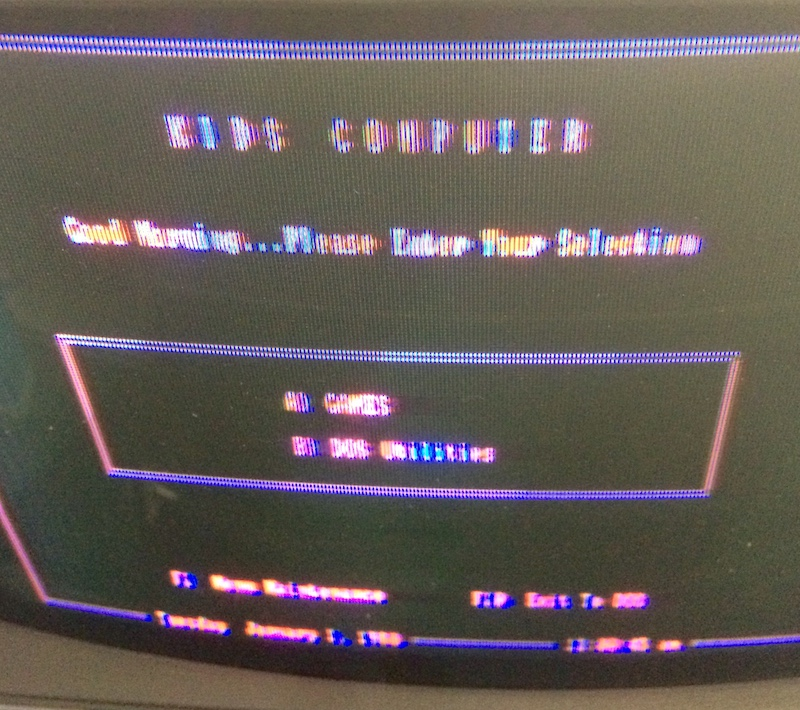 The Tandy 1000TX startup menu. It says KIDS COMPUTER and then Good Morning... Please Enter Your Selection A) Games B) DOS utilities
